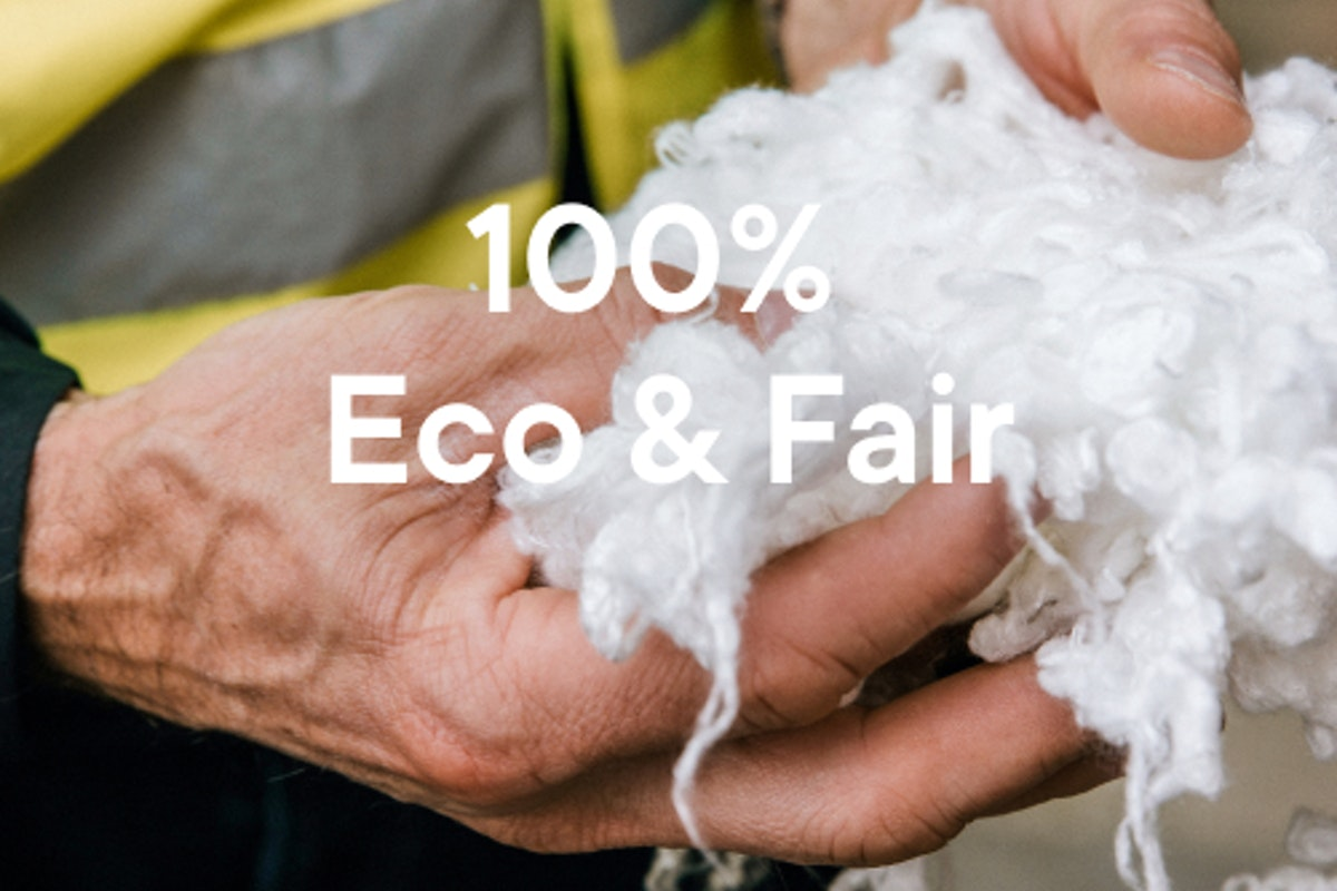 "Man holding cotton fluff with text that says ""100% Eco & Fair - view our materials""."