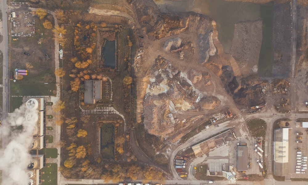 aerial view of a piece of land being cleared and under construction