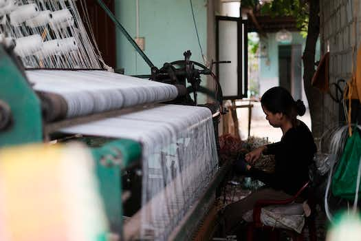 worker working on a fabric machine