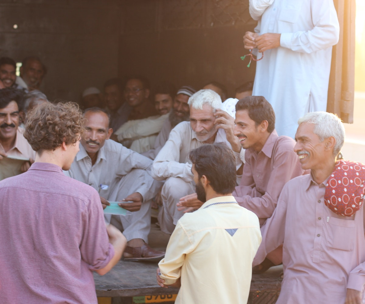 Jonathan in Pakistan speaking with team members at Ethletic